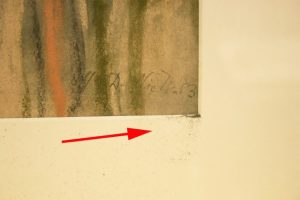 Damaged Pastel painting after acoustical vibrations are applied to the mock-up artwork by the subwoofer